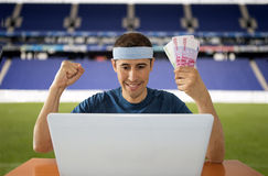 Online betting gaining euros in stadium. Online betting man and making a lot of euros in stadium Stock Photo