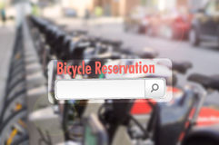 Online bike share reservation concept. With bicycles in background Royalty Free Stock Photography