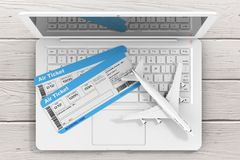 Online Booking Concept. Airline Boarding Pass Tickets with Jet A. Irplane over Laptop on a Wooden Table extreme closeup. 3d Rendering Stock Photography