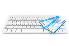 Online booking concept. Computer Keyboard with Bus Tickets Royalty Free Stock Photos