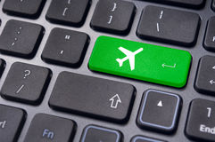 Online booking of flight ticket, with plane sign on keyboard Stock Image