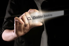 Online booking. Hand showing online booking text on the virtual screen stock photos