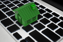 Online business concept with green house on keyboard. Online business concept with 3d rendering green house on keyboard Royalty Free Stock Images