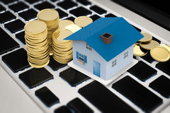 Online business concept with house and stack of coins. Online business concept with mock up house and stack of coins Stock Images
