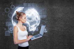 Online business concept. Side view of young businesswoman using laptop with digital financial charts, icons and globe. Online business concept Royalty Free Stock Photo