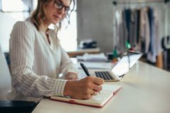 Online business owner working at her desk royalty free stock image