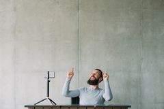 Online business training man smartphone top career. Online business training. Bearded man using smartphone on tripod, telling how to reach top of professional royalty free stock image