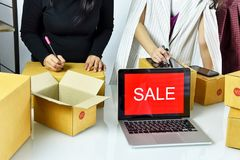 Online business, Young asian woman work at home for e-business commerce, Business owner checking and packing online order. stock image