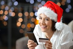 Online buyer looking at you on christmas. Lying on a couch in the living room at home stock photo