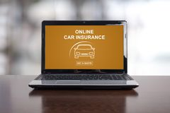 Online car insurance concept on a laptop. Screen royalty free stock photography