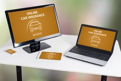 Online car insurance concept on different devices. Online car insurance concept shown on different information technology devices royalty free stock image