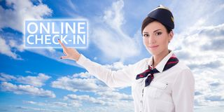 Online check-in - stewardess in uniform pointing at check-in but Royalty Free Stock Images
