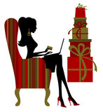 Online Christmas Shopping. Illustration of a young woman shopping for Christmas presents on the internet Royalty Free Stock Photo