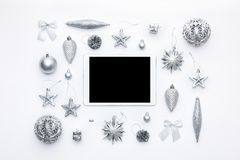 Online Christmas Shopping. Boxing Day Sale Background. Christmas ornaments and blank screen digital tablet isolated over white. Online Christmas Shopping stock images