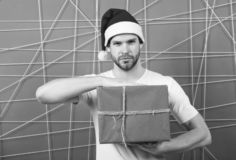 Online christmas shopping. Happy new year. delivery christmas gifts. happy santa man. man in santa hat hold christmas