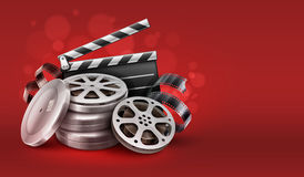 Online cinema with movie tape disks in boxes and directors clapper for filmmaking. Cinema film movie tape disks in boxes and directors clapper for filmmaking Royalty Free Stock Images