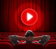 Online cinema screen with red curtain and play media button in center Royalty Free Stock Photos