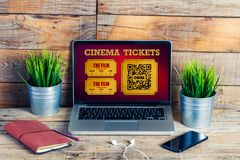 Online cinema tickets purchase in a laptop screen, at the office. Stock Images