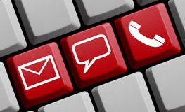 Online Contact icons on red keyboard Stock Image