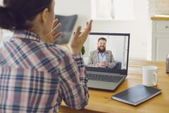 Free Online Conversation Meeting. A Man In A Video Call Laptop Talks To A Woman At Home. Stock Image - 184046541
