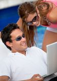 Online couple on vacation Stock Images