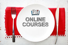 Online Courses concept on white plate Stock Photo