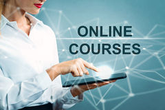 Online Courses text with business woman. Using a tablet Stock Photography