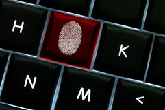 Online crime scene concept with the fingerprint. Left on a backlit keyboard Stock Photography