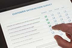 Online Customer Satisfaction Survey on Tablet in Office royalty free stock images