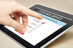 Online customer service. Satisfaction survey on a digital tablet Royalty Free Stock Photo