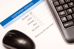 Online customer service satisfaction survey. Excellent checkbox on customer service satisfaction survey with keyboard and mouse Stock Image
