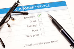 Online customer service satisfaction survey. Excellent checkbox on customer service satisfaction survey with keyboard and mouse Stock Images