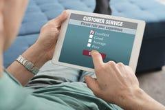 Online customer service satisfaction survey. On a digital tablet Stock Photos