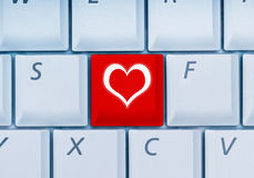 Online-dating. Picture showing keyboard with heart-key stock images