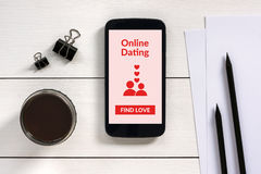 Online dating application mock up on smartphone screen. Top View Stock Photos
