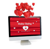 Online dating computer with hearts in the air Stock Image