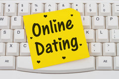 Online Dating, computer keyboard and sticky note Stock Photo