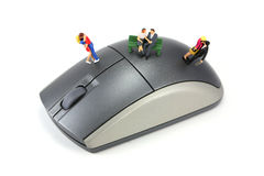 Online dating concept. Concept image depicting online/internet dating or matchmaking. There are three couples standing or sitting on a mouse. Isolated on white stock images
