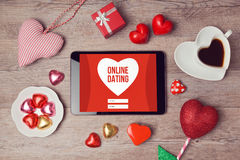 Online dating concept with digital tablet mock up and heart chocolates. Valentine's day romantic celebration Stock Photos
