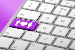 Online Dating Key on a Keybaord. A hetrosexual couple symbol on a metallic silver keyboard royalty free stock photography