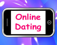 Online Dating  On Phone Shows Romancing Stock Photography