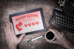 Online dating on a tablet Royalty Free Stock Photography