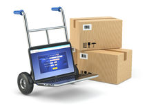 Online delivery concept. Laptop as hand truck and boxes. Stock Images