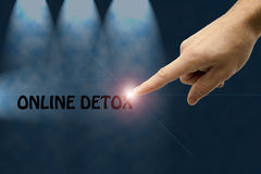 Online detox. Male hand pointing to a text Royalty Free Stock Image