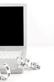 Online dieting. Measuring tape on white laptop. Copy space. Shallow Dof. Online dieting concept Royalty Free Stock Photo