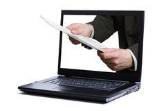 Online document. Hand offering a form through the laptop screen - concept for online document Stock Image