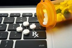 Online Drugs. Online prescription order concept with bottles of medicine on keyboard Royalty Free Stock Photo
