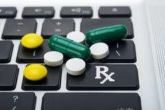 Online Drugs. Online prescription order concept with bottles of medicine on keyboard Royalty Free Stock Image