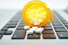 Online Drugs. Online prescription order concept with bottles of medicine on keyboard Royalty Free Stock Images