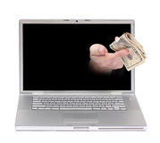 Online earning. Hand with money coming out of the screen of a laptop over white Royalty Free Stock Photo